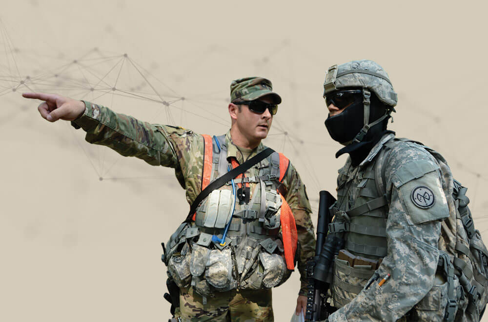 N.Y. National Guard Soldier, MSG Scott Kyle, assigned to headquarters, 106th Regional Training Institute, identifies a student's target during a field training exercise on the Camp Smith Training Site, Cortlandt Manor, N.Y.