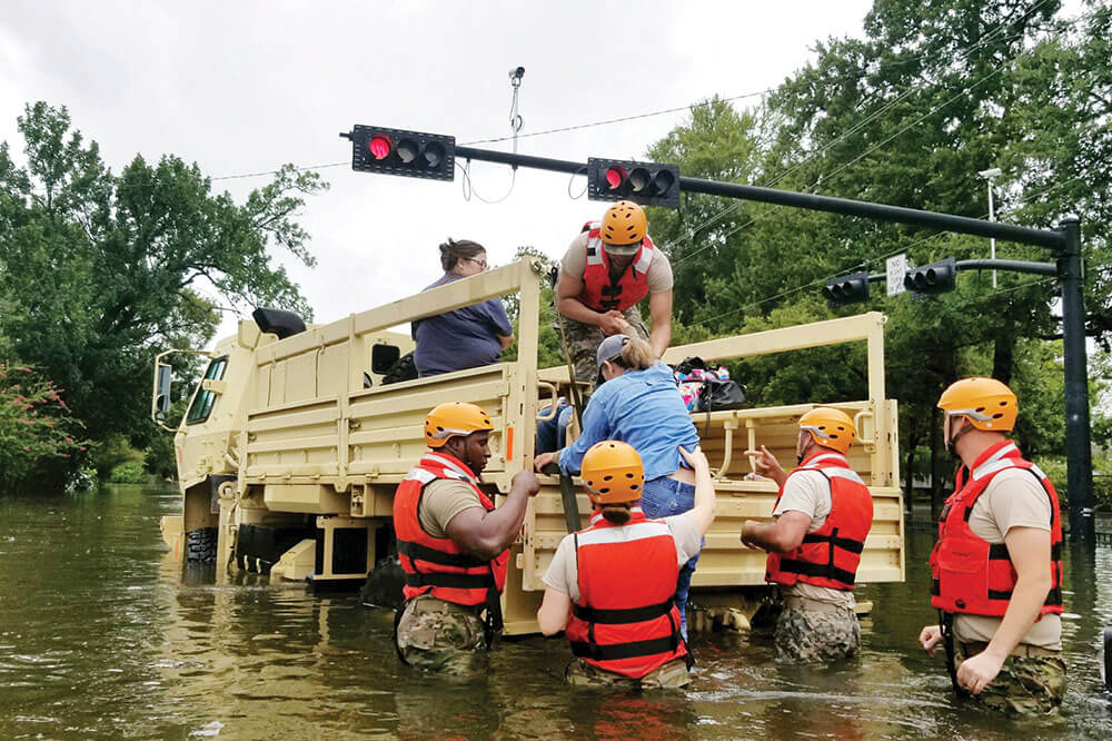 Soldiers with Texas Army National Guard rescue Houston residents as floodwaters from Hurricane Harvey continue to rise.