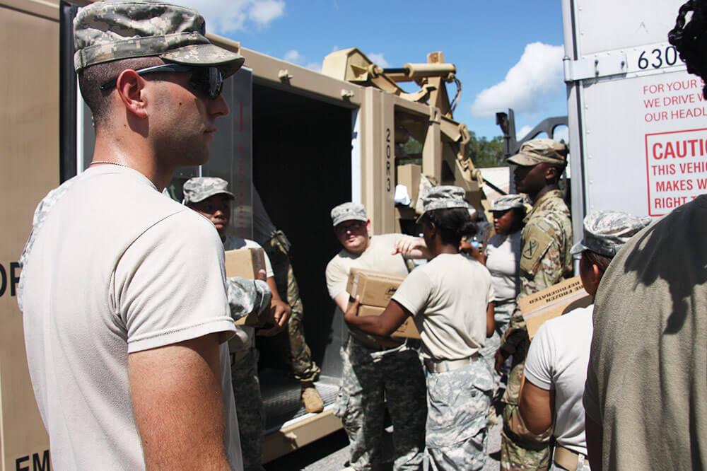 South Carolina National Guard Soldiers assigned to the 1118th Forward Support Company load pods with food and water for transport to south Florida in response to Hurricane Irma.