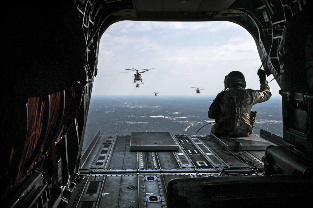 A formation of six South Carolina Army National Guard CH-47F Chinook heavy-lift cargo helicopters assigned to Detachment 1, B Company, 2-238th, General Support Aviation Battalion, 59th Aviation Troop Command, departs for a year-long deployment to Afghanistan.