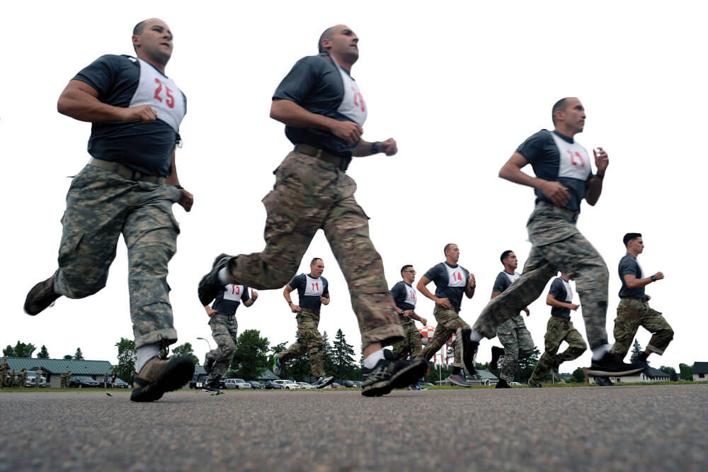 Soldiers participating in the 2017 Army National Guard Best Warrior Competition, held at Camp Ripley, Minn., head out on a two-mile run wearing their competitor numbers.