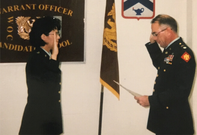 CW5 Bryan is sworn in as a warrant officer in November 1999.