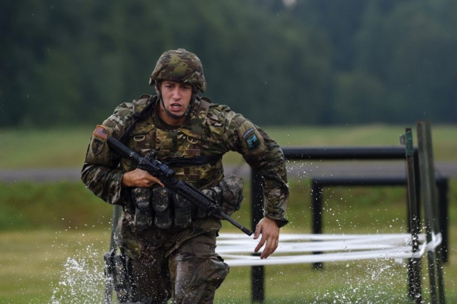 ARNG SGT Zachary Scuncio, a military police officer with the Rhode Island Army National Guard's 169th Military Police Company, runs to his next objective while competing in the 2017 Best Warrior Competition at Camp Ripley, Minn.