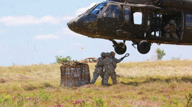 Soldiers From The Tennessee National Guard's Regimental Support Squadron, 278th Armored Cavalry Regiment, perform sling load operations on Black Hawks from the Minnesota National Guard's 2-147 Assault Helicopter Battalion during an exportable Combat Training Capability exercise at Fort Hood, Texas.