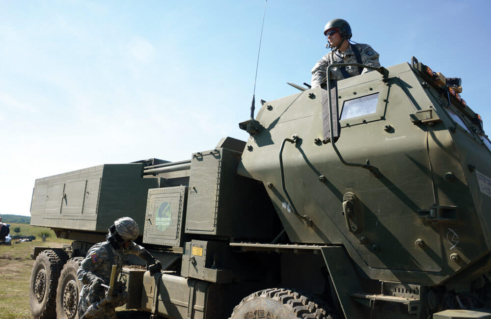 Soldier of the 5th Battalion, 113th Field Artillery Regiment, waits for refueling of a High Mobility Artillery Rocket System.