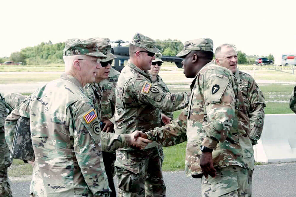 COL Carlton Smith (right) greets senior leaders to the area of operations for Hurricane Harvey relief efforts.