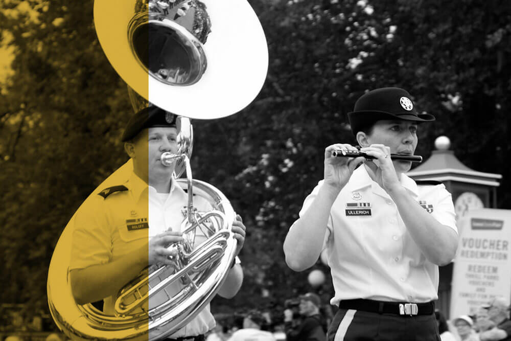 The 34th Army Band Concert and Marching Band performs in an Iowa State parade.