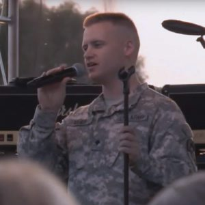 SGT Mark Meier sings a solo with Musical Performance Team, the Sidewinders.