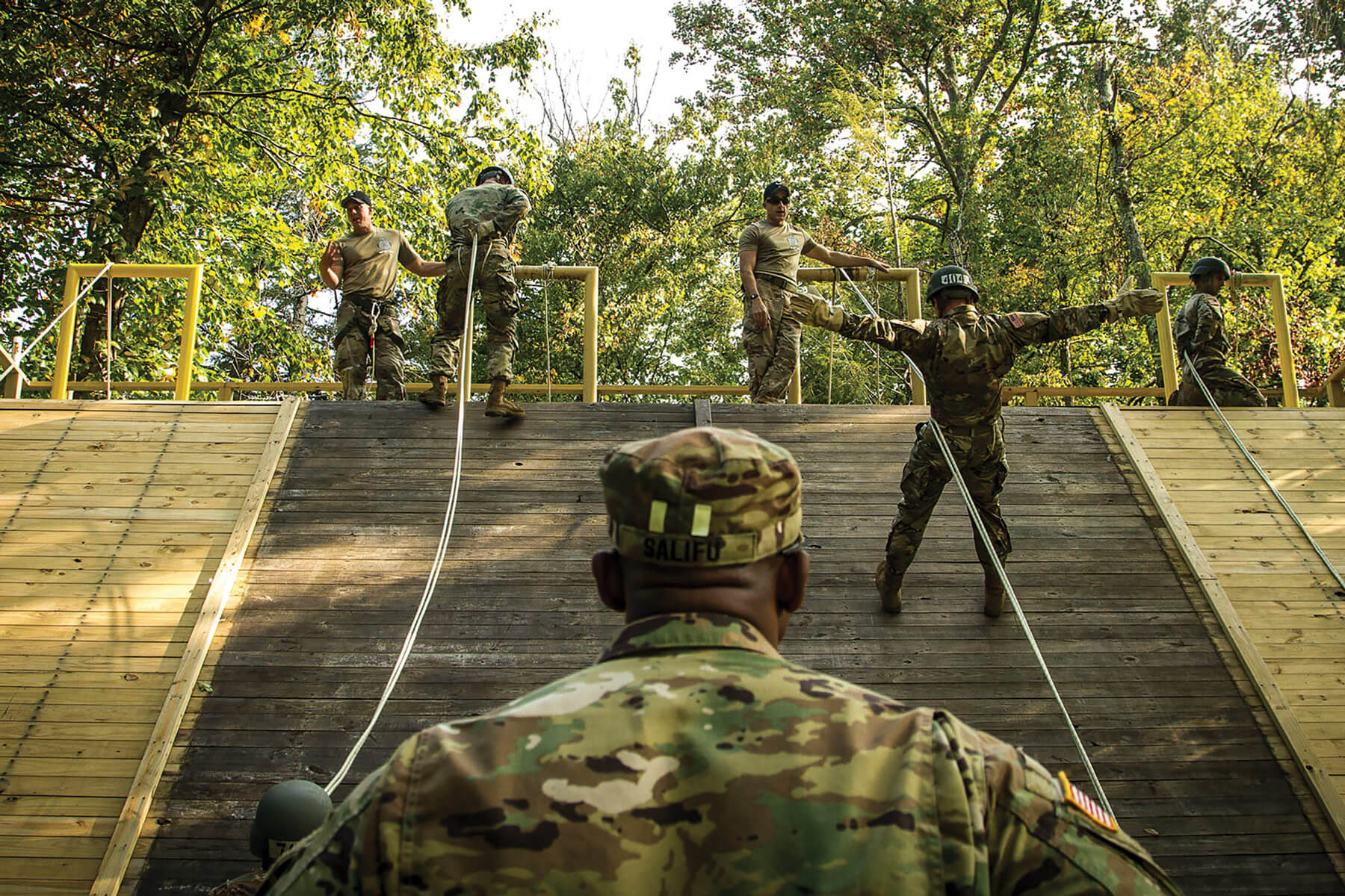 Army air assault students learn rappelling techniques during a class at the Army National Guard Warrior Training Center at Camp Dawson in Kingwood, W.Va.