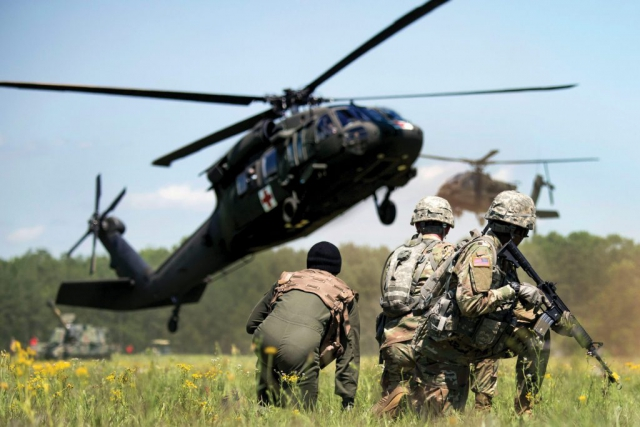 Army National Guard Soldiers await the arrival of a UH-60 Black Hawk medevac helicopter during the South Carolina National Guard Air and Ground Expo at McEntire Joint National Guard Base, S.C.