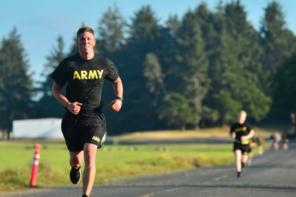Oregon Army National Guard SGT Kenith Landis, Delta Battery, 2nd Battalion, 218th Field Artillery Regiment, 41st Infantry Brigade Combat Team, completes his first loop of a 2-mile run during an Army Physical Fitness Test.