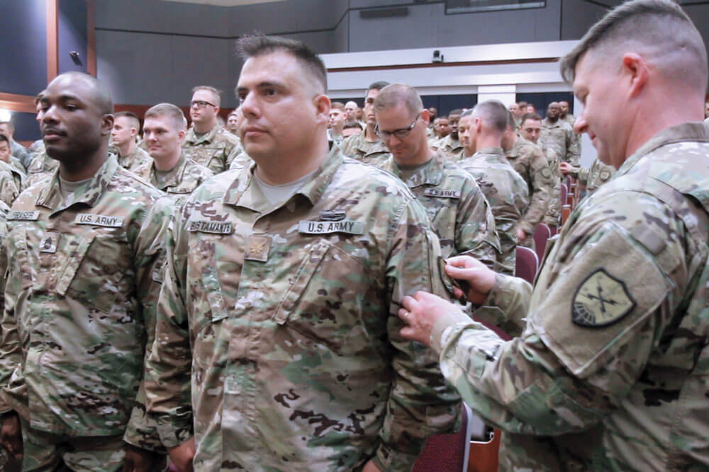 Members of the Virginia National Guard's newly-activated Bowling Green-based 91st Cyber Brigade receive their new shoulder sleeve insignia at Fort Belvoir, Va.
