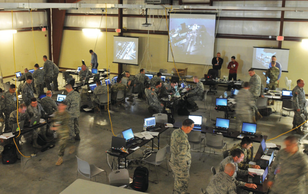 National Guard Soldiers and Airmen operate as blue team defenders in the Cyber City area of operations during exercise Cyber Shield 2016 at Camp Atterbury, Ind.