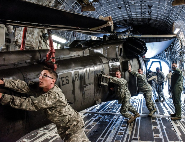 Tennessee National Guard Soldiers push a UH-60 Black Hawk into a C-17 aircraft carrier at Joint Base Berry Field, Nashville, Tenn. The Tennessee Guard deployed to the U.S. Virgin Islands to support disaster relief efforts and provide humanitarian aid in the aftermath of Hurricane Irma.