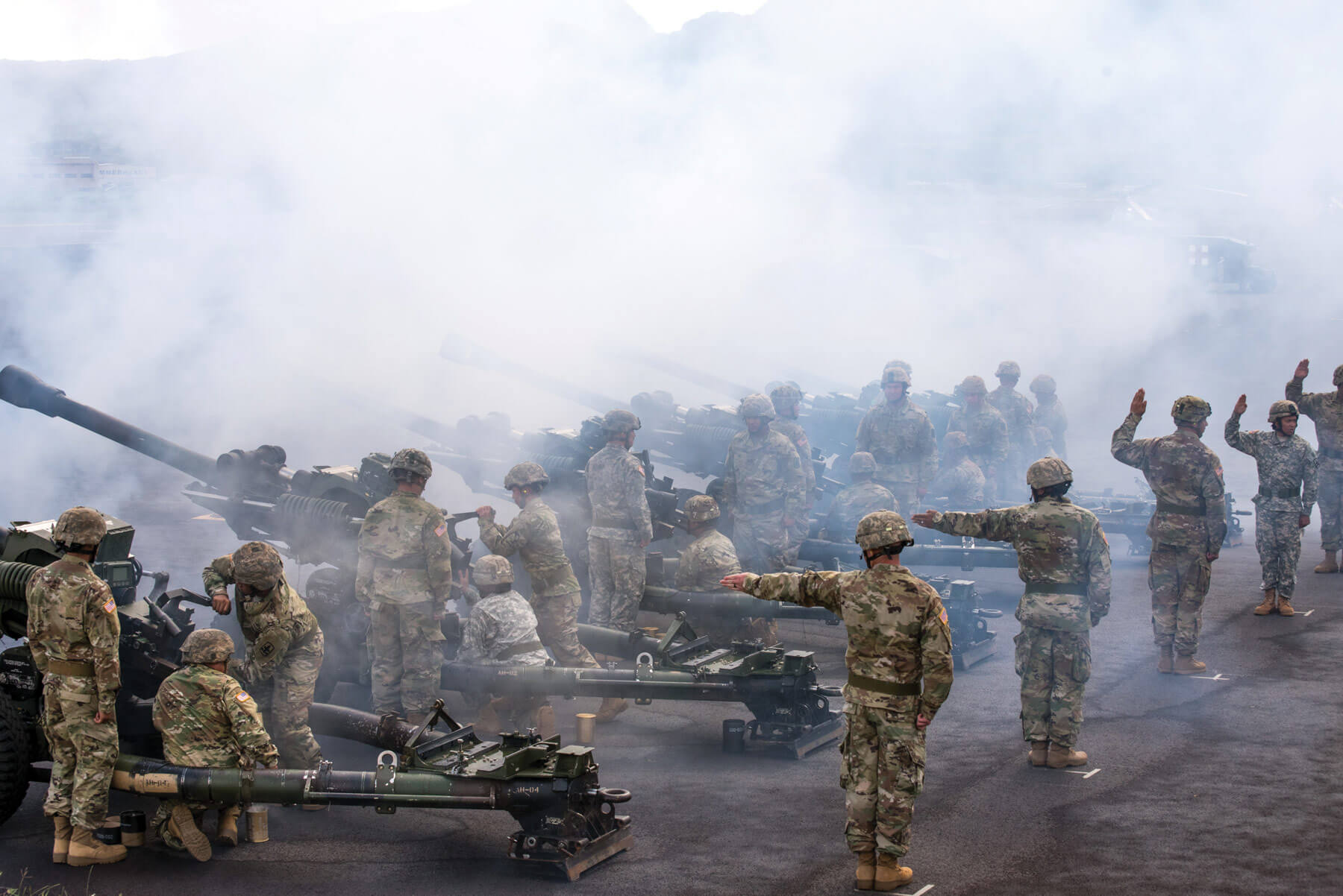 The 487th Field Artillery renders honors during the Hawaii Army National Guard Change of Command ceremony at Wheeler Army Airfield, Hawaii. All Hawaii Army National Guard units and service members were in attendance at the ceremony.