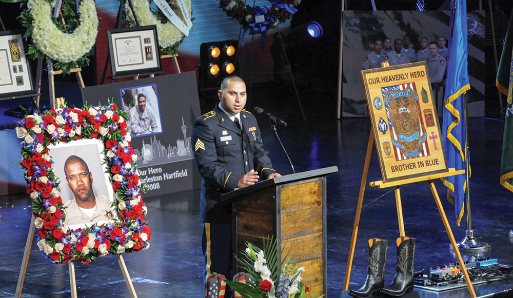 SGT Abdiel Roman, 100th Quartermaster Company, speaks at the memorial service for 1SG Charleston Hartfield on Oct. 20, 2017. Nevada Army National Guard photo by SSG Victor Joecks.
