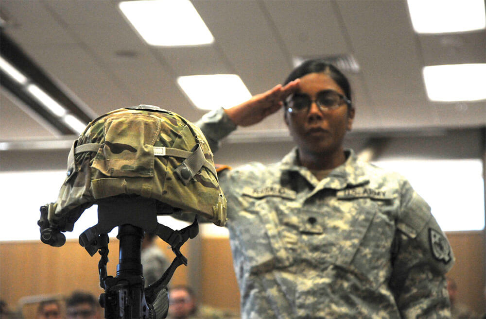 A Soldier pays her final respects to 1SG Charleston Hartfield after his memorial service held at the North Las Vegas Readiness Center on Oct. 21, 2017. Nevada Army National Guard photo by SSG Victor Joecks.