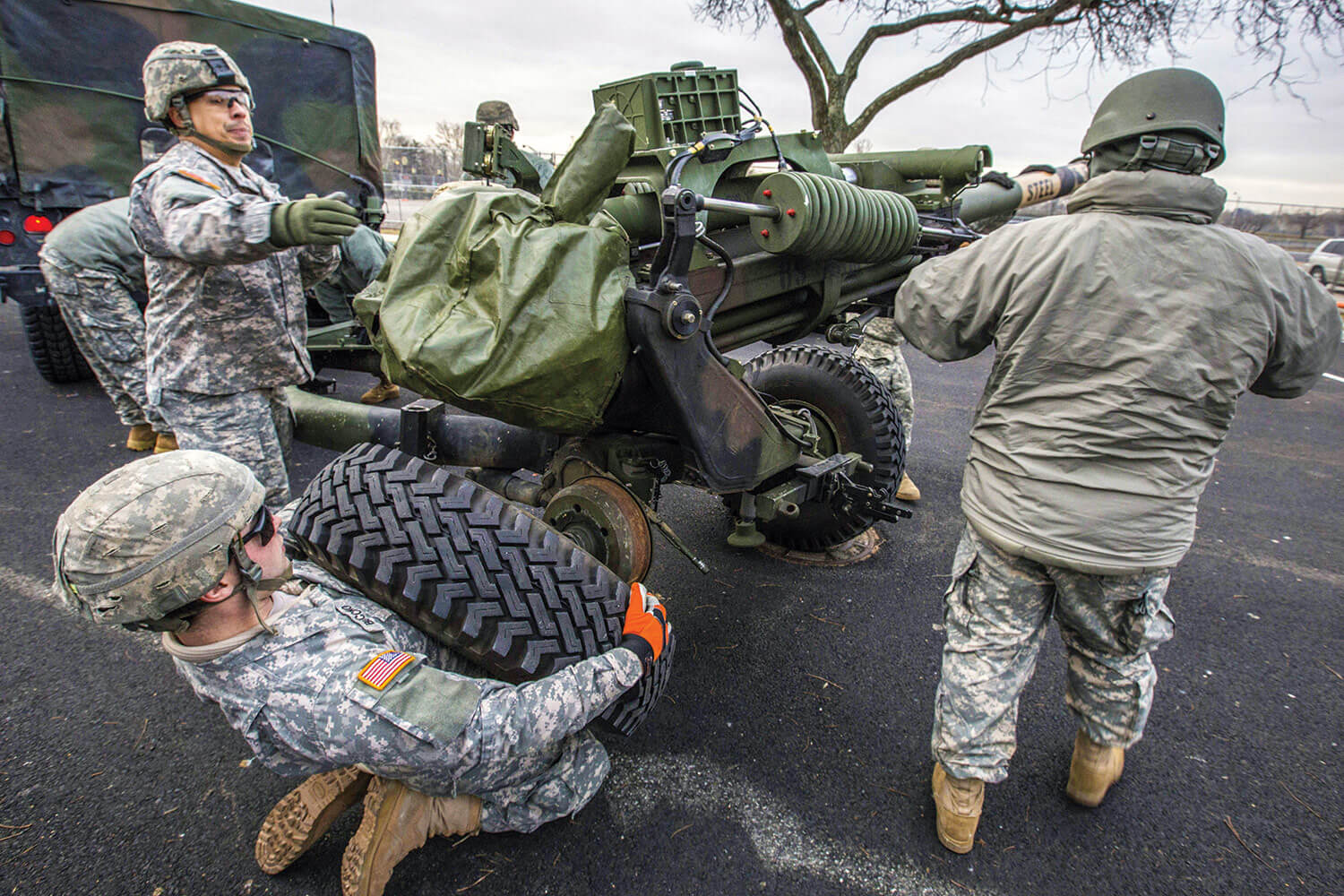 New Jersey Army National Guard Soldiers prepare an M119A3 howitzer for a 19-gun salute as part of the inauguration ceremony for New Jersey Gov. Phil Murphy at the War Memorial in Trenton, N.J., Jan. 16, 2018. New Jersey National Guard photo by Mark C. Olsen.