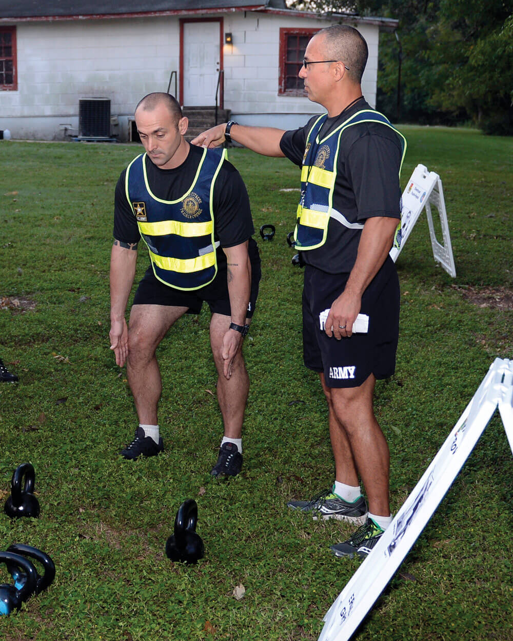 SSG Anthony Delagarza and SFC Athan Schindler, both Master Fitness Trainer Course instructors, Texas Army National Guard, demonstrate proper form during a round of circuit exercises at Camp Mabry as part of the Master Fitness Trainer Course.