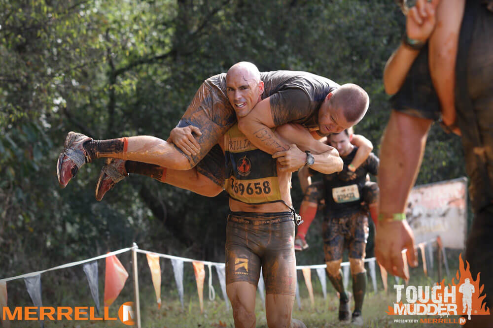 CPT Robert Killian competes in the Hero Carry event during the Tough Mudder Carolina 2017 competition.