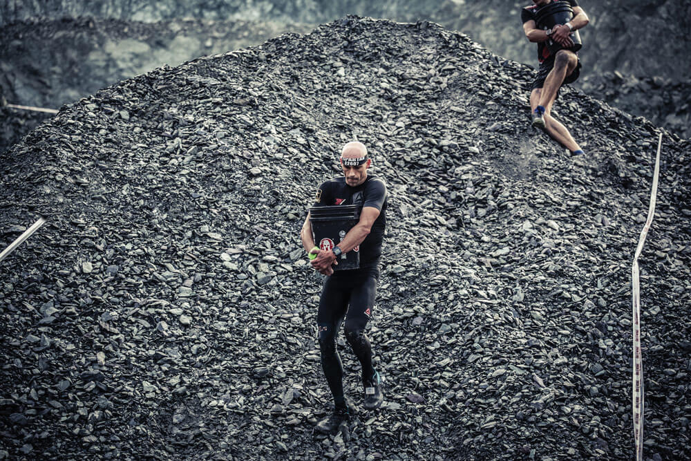 As part of the 2017 Oberndorf/Tirol Spartan Beast race held in Oberndorf, Austria, CPT Robert Killian races down a man-made hill during the Bucket Carry segment of the race.