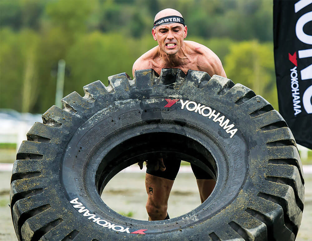 CPT Robert Killian digs deep to flip a giant tire during the Yokohama Tire Flip segment of the 2017 Seattle Super and Sprint Spartan Race.