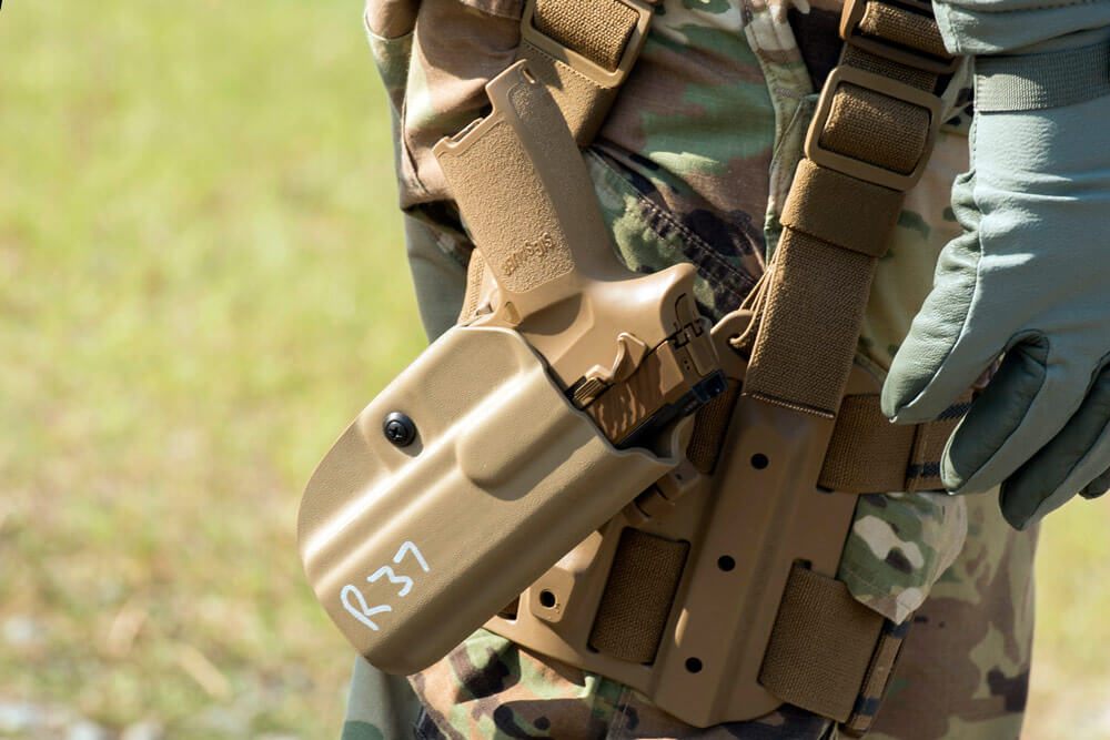 A Soldier wears the new M17 holstered at his hip during a field test for the U.S. Army Operational Test Command conducted at Fort Bragg, N.C. U.S. Army photo by Lewis Perkins