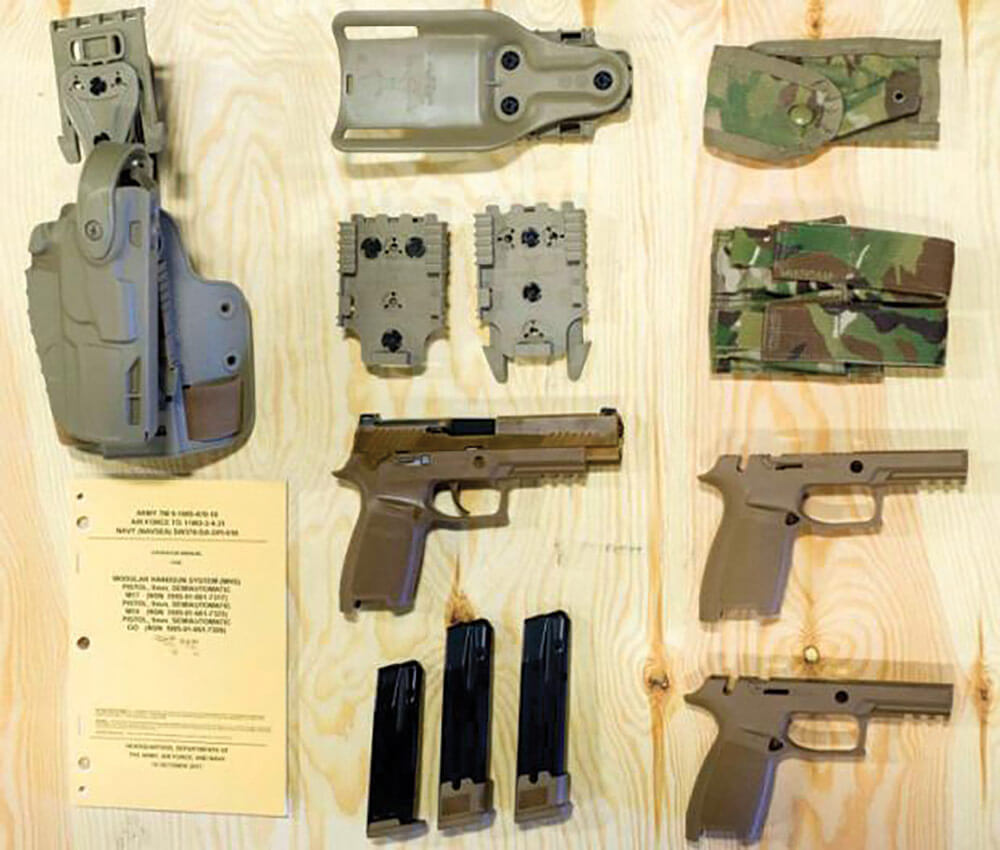 The Modular Handgun System includes an integrated rail for attaching enablers, an Army standard suppressor conversion kit to attach an acoustic/flash suppressor, clips for multiple caliber rounds and interchangeable grips. U.S. Army photo courtesy 101st Airborne Division