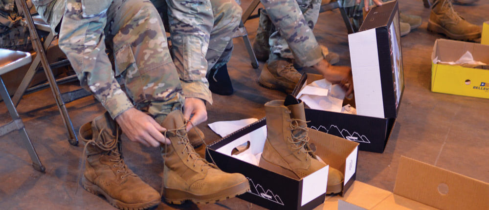 Soldiers try on the new Jungle Combat Boot. Units with a high need will begin to receive the boot as standard issue gear in 2019. U.S. Army photo by SSG Armando R. Limon