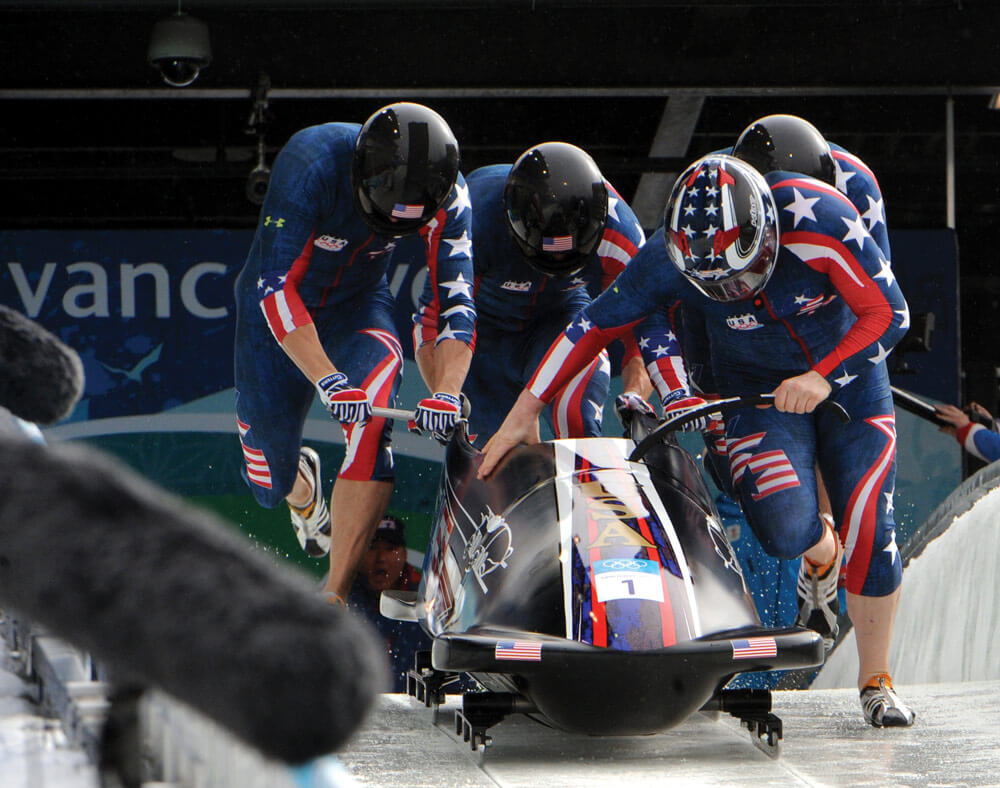 """SGT Justin Olsen and members of team USA-1, aka """"The Night Train,"""" compete in the four-man bobsleigh event in Whistler, British Columbia, at the 2010 Winter Olympics. U.S. Army photo by Tim Hipps"""