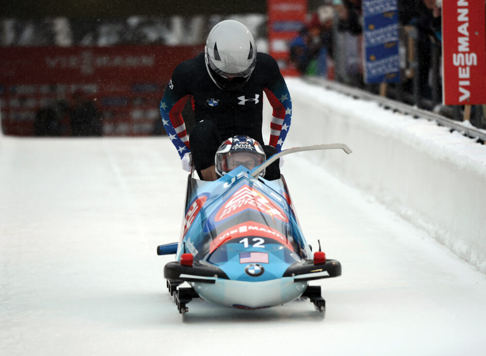 SGT Nick Cunningham (front) and teammate SGT Dallas Robinson slide to second place in the two-man event at the International Bobsled & Skeleton Federation's 2013 World Cup stop. U.S. Army photo by Tim Hipps