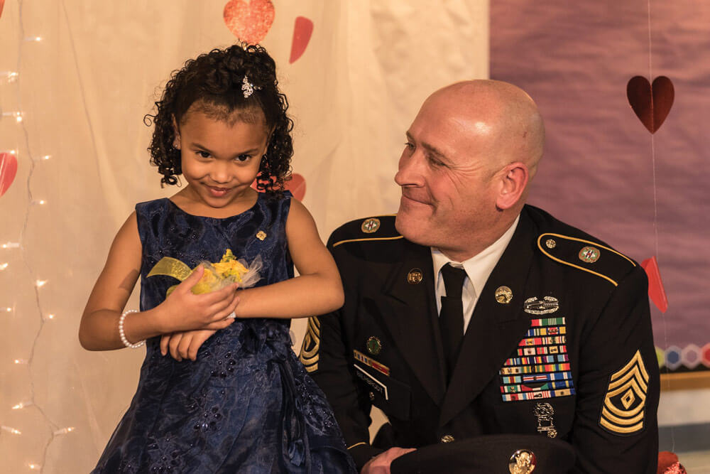 Illinois Soldier Escorts Gold Star Daughter to School Dance thumbnail image