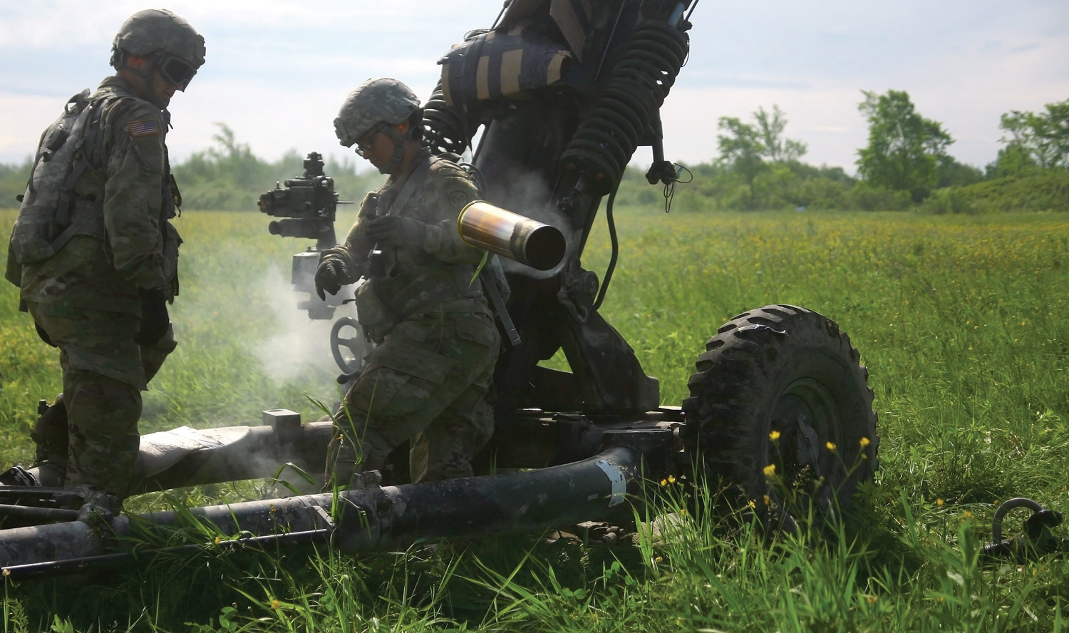 U.S. Soldiers assigned to Alpha Battery, 1st Battalion, 258th Artillery Regiment, 27th Infantry Brigade Combat Team, New York Army National Guard, man an M119A2 Howitzer during a notional air assault artillery raid where Soldiers engaged a simulated enemy target at Fort Drum, N.Y. New York Army National Guard photo by SGT Alexander Rector