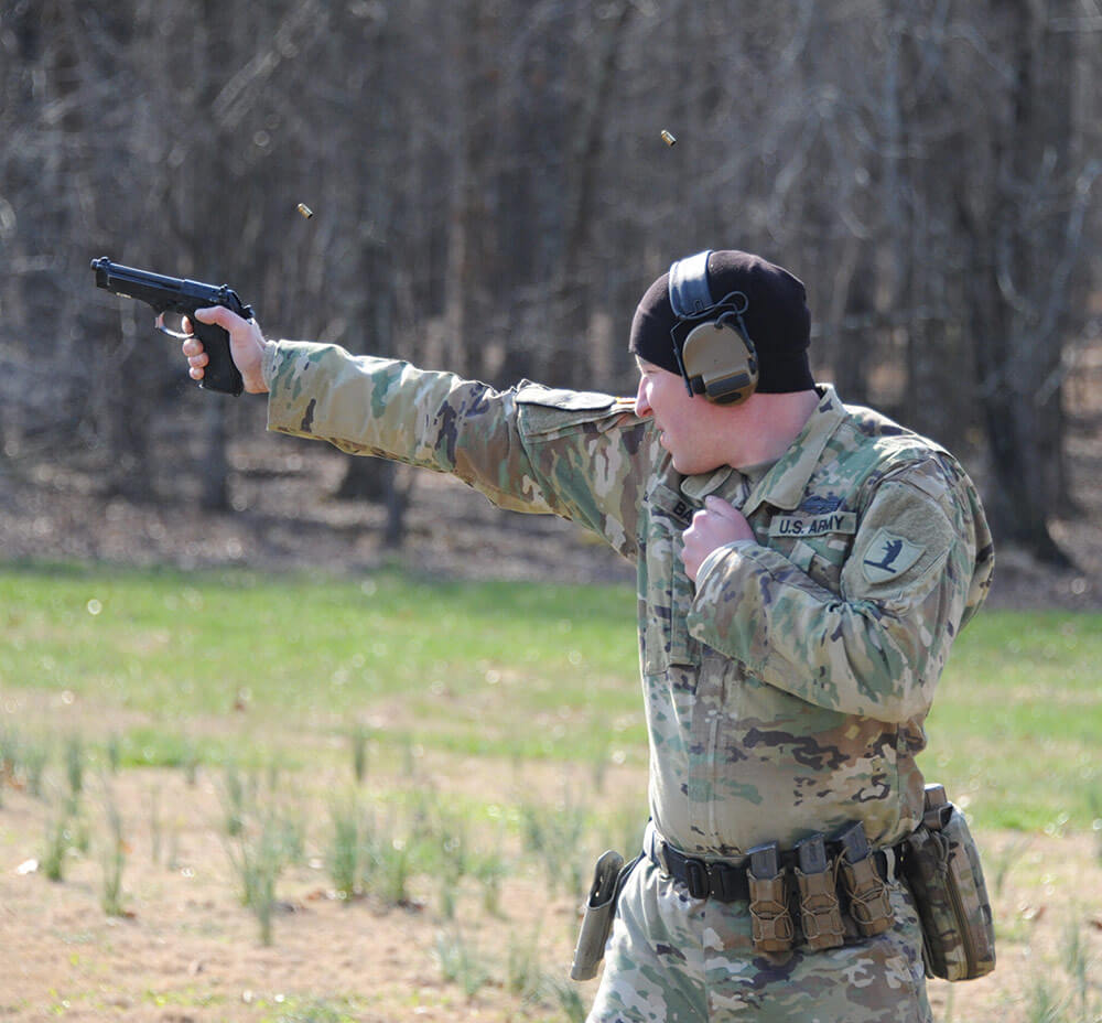 SGT David Ball, Missouri Army National Guard, practices the service pistol style shooting while engaging paper targets with his M9 pistol during a trainup for the U.S. Army Small Arms Championships.