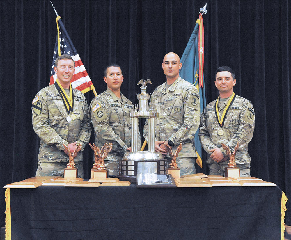 The winning Missouri National Guard team poses with their 2018 Overall Small Arms Team Champion trophies. Left to right: SGT David Ball, SSG Jerry Dement, 1SG James Phelps, SSG Michael Richey.