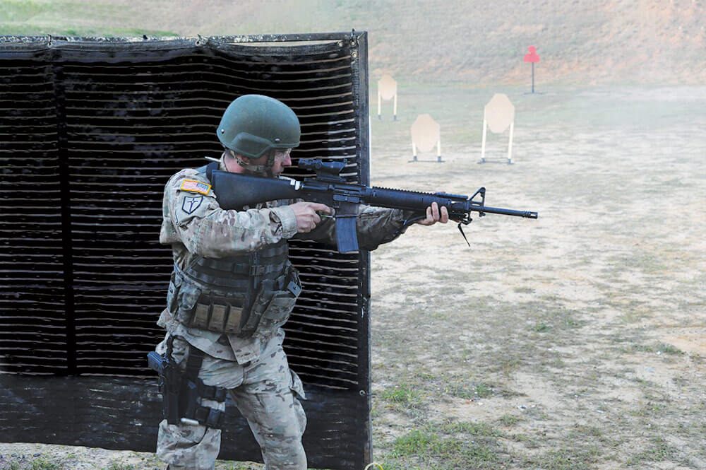 SSG Michael Richey, Missouri Army National Guard, engages targets with an M16A2 rifle during the Multi-gun Match at the 2018 U.S. Army Small Arms Championships March 11–17, 2018, at Fort Benning, Ga.