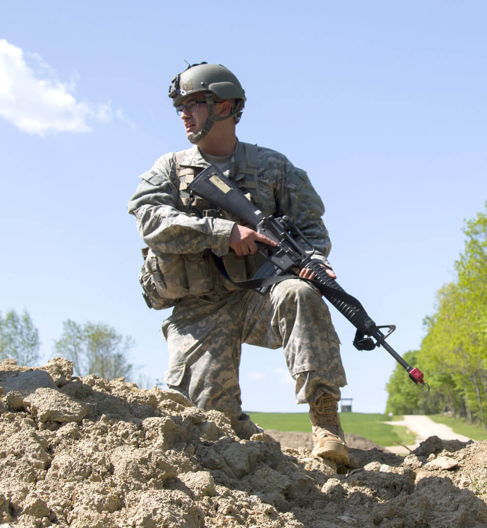 An Army National Guard officer candidate observes Soldiers clearing a make-shift bunker during an OCS Field Leadership Exercise at the New Hampshire National Guard Training Site in Center Strafford, N.H.. Vermont Army National Guard photo by SPC Avery Cunningham