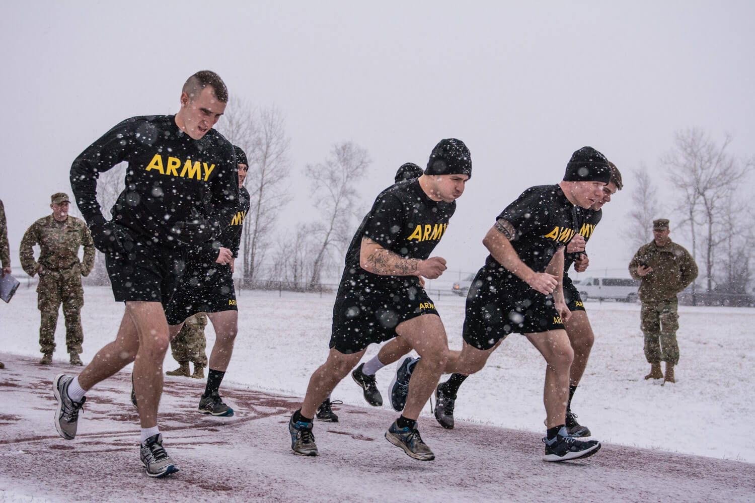 Soldiers from the Maine Army National Guard plow through the snow during the Army Physical Fitness Test at the Armed Forces Reserve Center track in Bangor, April 6, 2018. These Soldiers are competing in the State level of the Best Warrior Competition. Competitors are handpicked as the best representatives the State has to offer from over 2000 members of the Maine Army National Guard. Maine Army National Guard photo by SPC Jarod Dye