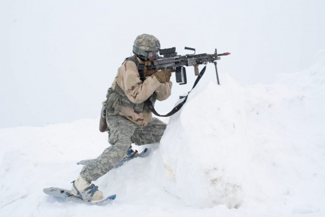 An Alaska Army National Guard Soldier lines up his shot as he plays the role of OPFOR during a notional attack at the Murphy Dome Long Range Radar Site near Fairbanks, Alaska. The scenario was part of Arctic Eagle 2018 – a cold-weather training exercise hosted by the Alaska Army National Guard. It was held Feb. 20 – March 8 and took place at multiple locations across Alaska including Fairbanks, Valdez, the Alaska/Canada Boarder, Joint Base Elmendorf–Richardson, and Fort Greely. National Guard Bureau photo by Lauren di Scipio