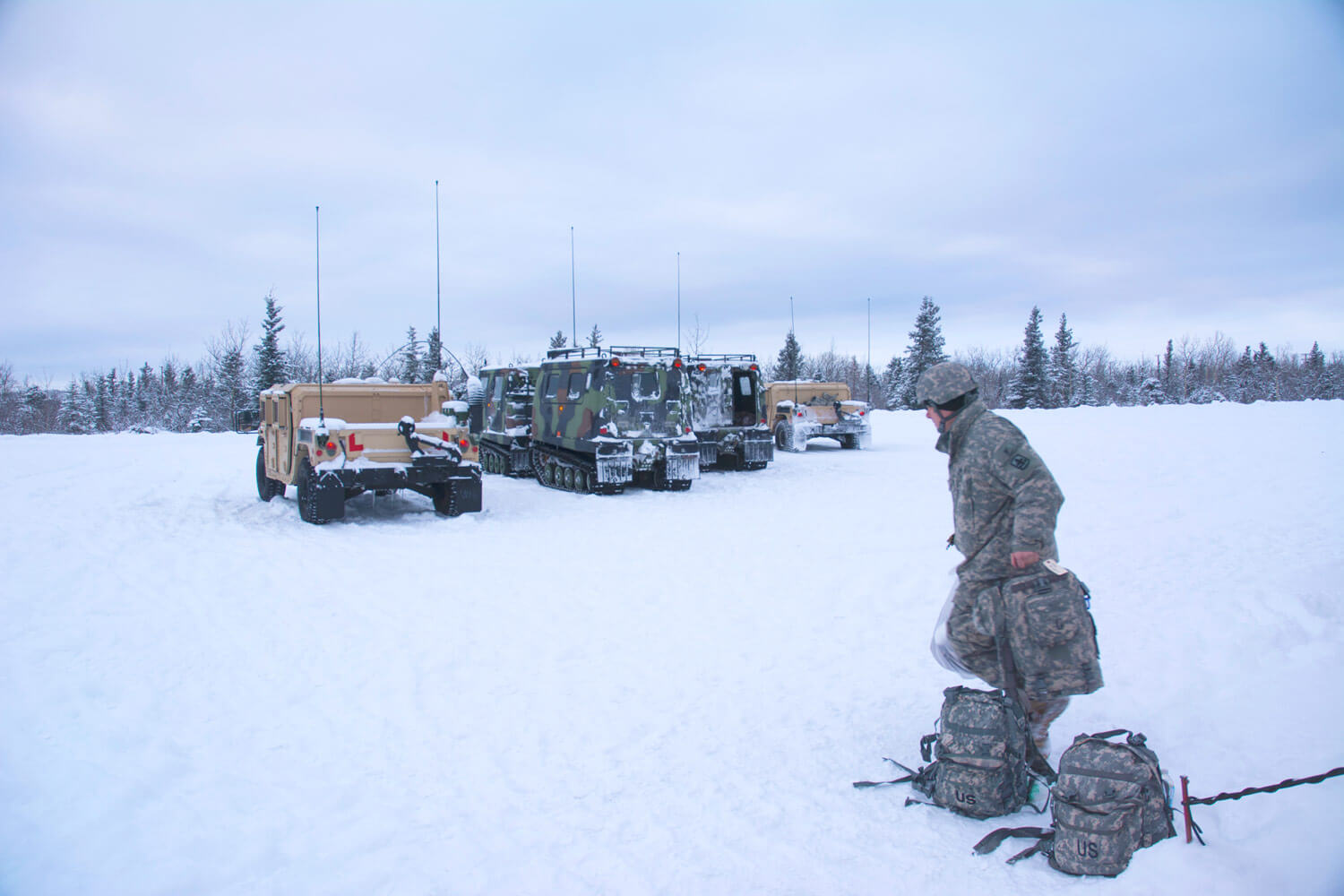 A Soldier from the 29th Infantry Brigade, Hawaii Army National Guard prepares to load supplies onto a HMMWV at Fort Greely, Alaska after a snow storm during Arctic Eagle 2018. Arctic Eagle was a cold-weather training exercise hosted by the Alaska Army National Guard. It was held Feb. 20 – March 8 and took place at multiple locations across Alaska including Fairbanks, Valdez, the Alaska/Canada Boarder, Joint Base Elmendorf–Richardson, and Fort Greely. National Guard Bureau photo by Lauren di Scipio