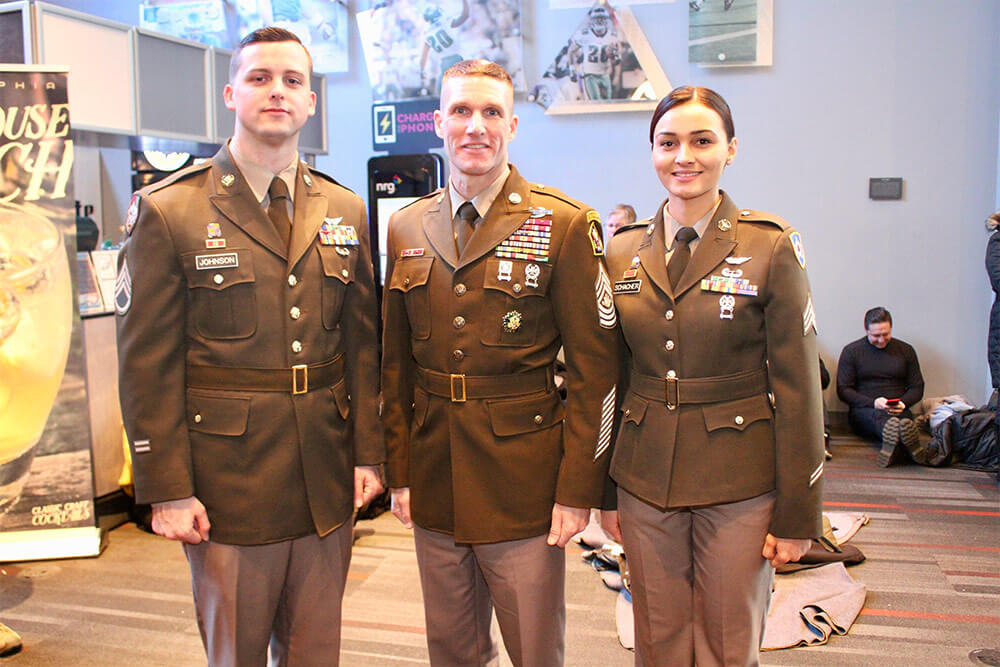 Sergeant Major of the Army SGM Daniel Dailey (center) and Soldier models SSG Aaron Johnson (left) and SGT April Schacher (right) showcase the newly proposed Pinks & Greens daily service uniform at the 2017 Army-Navy game in Philadelphia, Pa. U.S. Army photo by Ron Lee