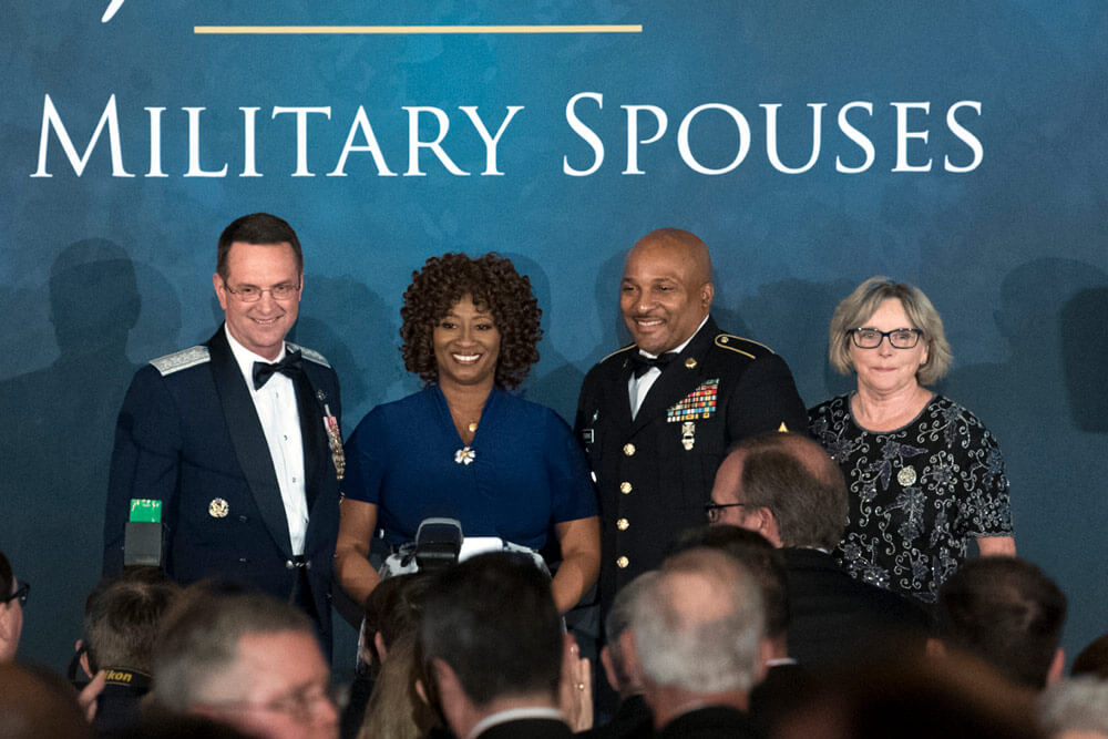 Shelia Brookins (2nd from left) poses for photos with Air Force Gen Joseph Lengyel (far left), chief of the National Guard Bureau, her husband SFC Darrell Brookins, and Sally Lengyel, wife of Gen Lengyel, at the USO of Metropolitan Washington-Baltimore's 36th Annual Awards Dinner in Washington, D.C., where she accepted the 2018 Armed Forces Insurance National Guard Spouse of the Year Award, May 10, 2018. DoD photo by EJ Hersom