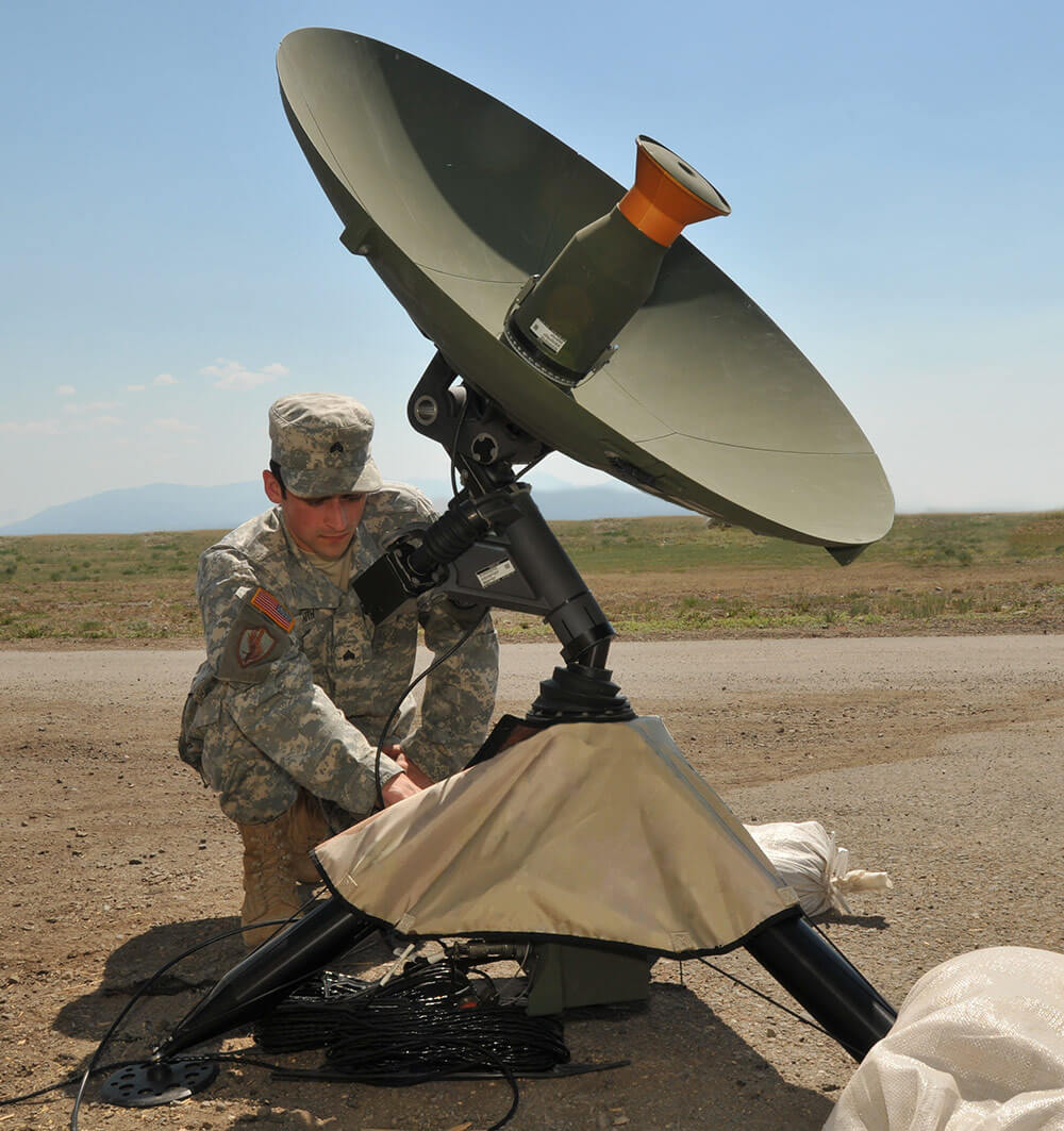 Colorado Army National Guard SGT Nathan Faith, 117th Space Battalion, checks a satellite dish in advance of GPS monitoring and satellite image gathering conducted by members of the battalion. Colorado National Guard photo by TSgt Wolfram M. Stumpf