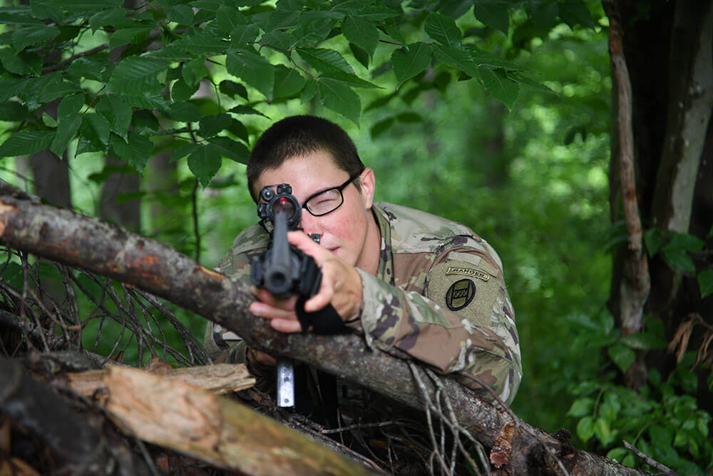 1LT Emily Lilly, a platoon leader with Charlie Troop, 1st Squadron, 150th Cavalry Regiment and the first female Soldier in the Army National Guard to graduate from the U.S. Army Ranger School aims her weapon on a trail at Yeager Air National Guard Base in Charleston, W.Va. National Guard Bureau photo by Luke Sohl