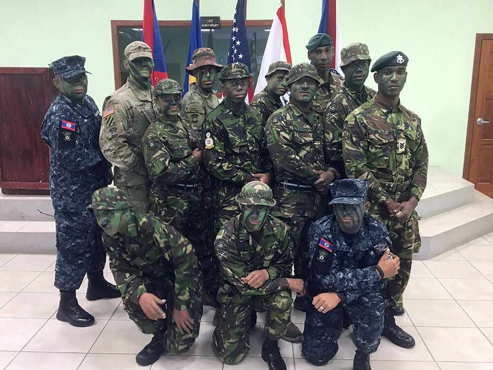 Louisiana National Guard 1LT Kenrick Cormier (second from left, back row) stands with his fellow graduates from the Belize Defense Force's 2017 Jungle Warfare Instructor Course. Photo courtesy Belize Defense Force