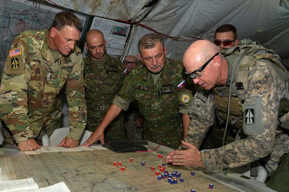Indiana Army National Guard COL Robert Burke strategizes a training assault with (left to right) MG Courtney P. Carr, Indiana National Guard adjutant general, Slovak Col. Roland Bartakovics and Slovak Gen. Milan Maxim, during a multinational training exercise held at Fort Polk, La., 2017. The Indiana National Guard and Slovak Armed Forces celebrate a 20-year State partnership. Indiana Army National Guard photo by MSG Jeff Lowry