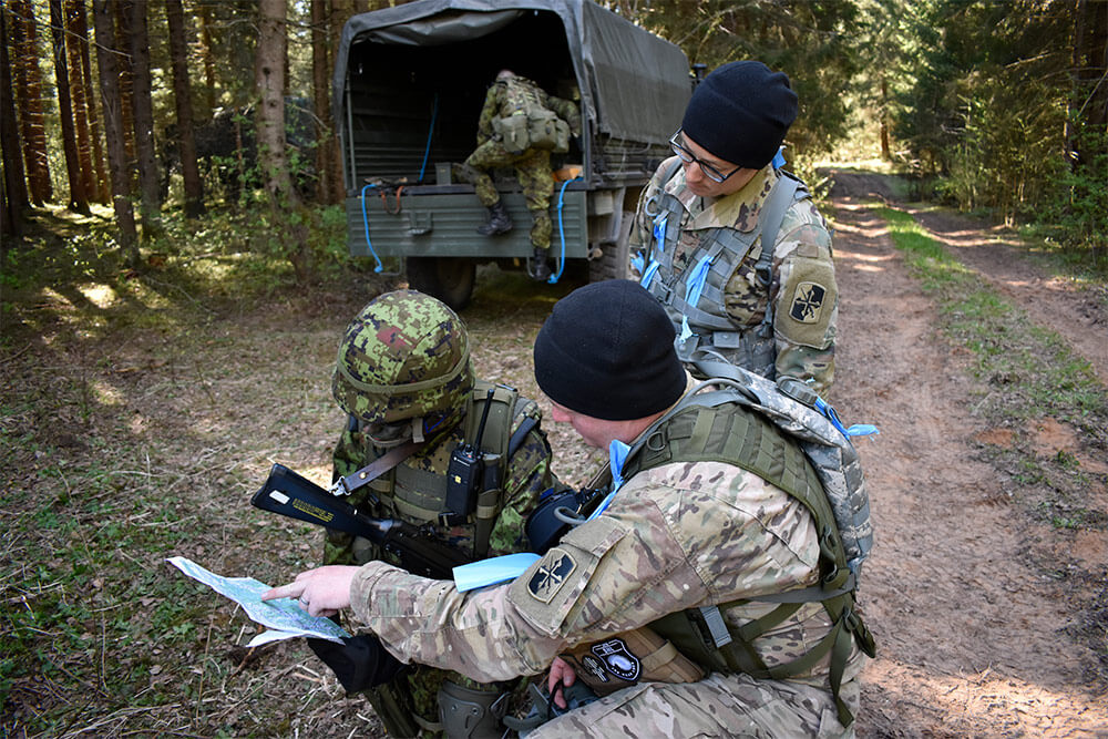 Soldiers from the Maryland Army National Guard, 629th Expeditionary Military Intelligence Battalion work as observers and controllers as soldiers from the Estonian Defense Force's 2nd Brigade conduct recon operations, May 6 2018, as part of Exercise Hedgehog held in Southern Estonia. This year, the Maryland National Guard and the Estonian Defense Force celebrate 25 years of partnership. Maryland Army National Guard photo by MAJ Kurt M. Rauschenberg