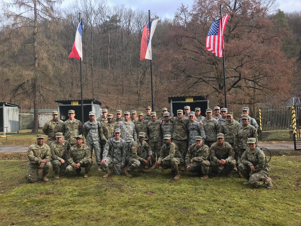 Soldiers of the Texas Army National Guard and Indiana Army National Guard take a team photo while deployed to work with members of the Czech Republic and Slovakian military forces during Operation Toxic Lance held in March 2018, at Training Area Lest in central Slovakia.