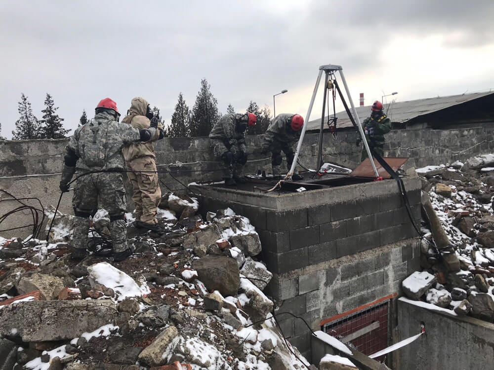 Soldiers of Texas Army National Guard's 836th Engineer Company work alongside their fellow Soldiers from Indiana Army National Guard's 438th Chemical Company during Operation Toxic Lance – a chemical warfare training exercise hosted by the Slovakian CBRN Battalion, in March 2018.