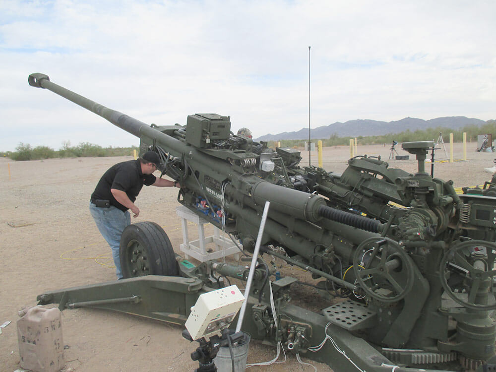 An ARDEC engineering staff member checks instrumentation on the Extended Range M777A2 between firing occasions during a live fire test at Picatinny Arsenal. Photo courtesy U.S. Army